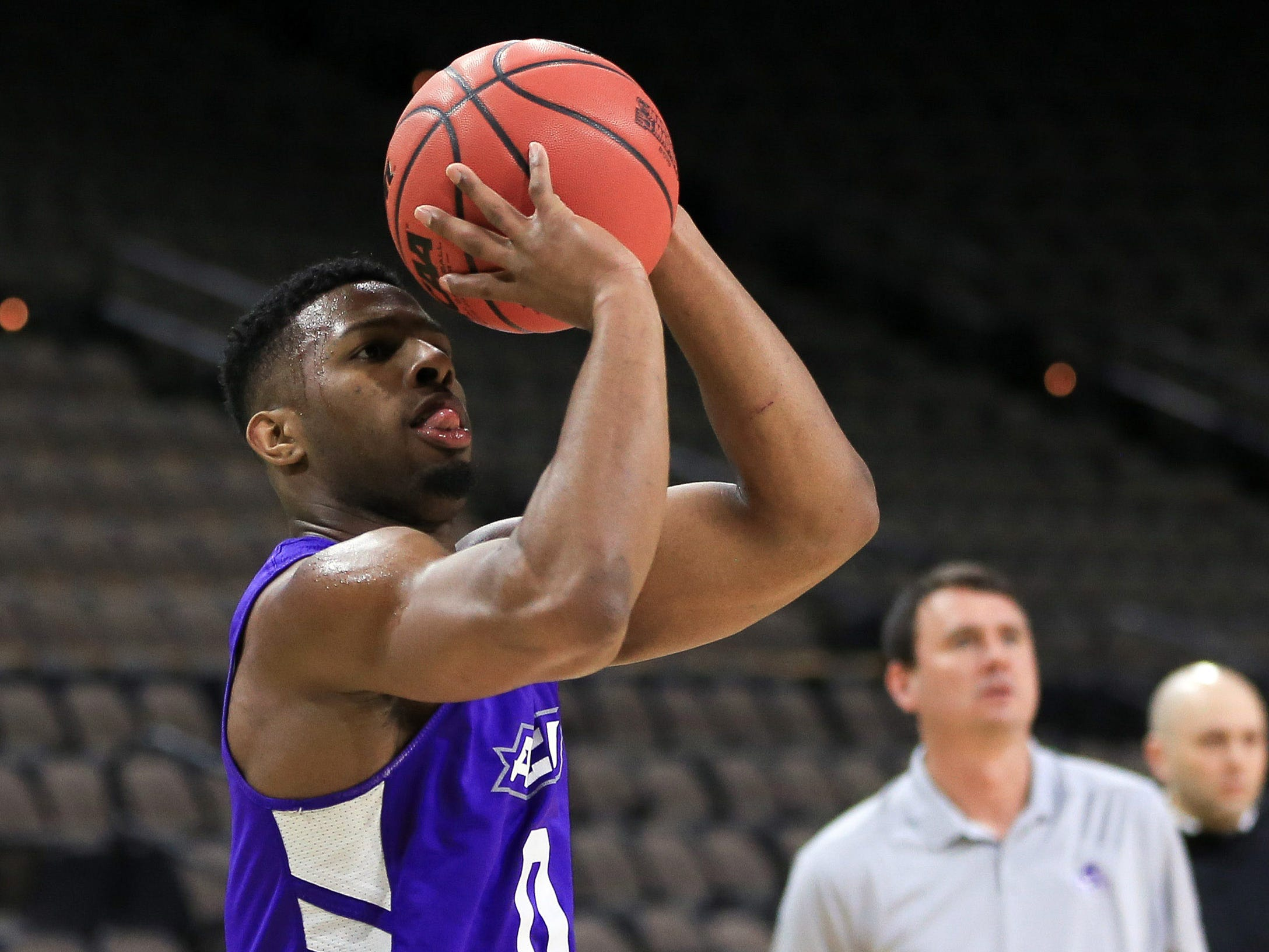 Mar 20, 2019; Jacksonville, FL, USA; Abilene Christian Wildcats guard Jaylen Franklin (0) shoots as head coach Joe Golding watches during practice day before the first round of the 2019 NCAA Tournament at Jacksonville Veterans Memorial Arena. Mandatory Credit: Matt Stamey-USA TODAY Sports