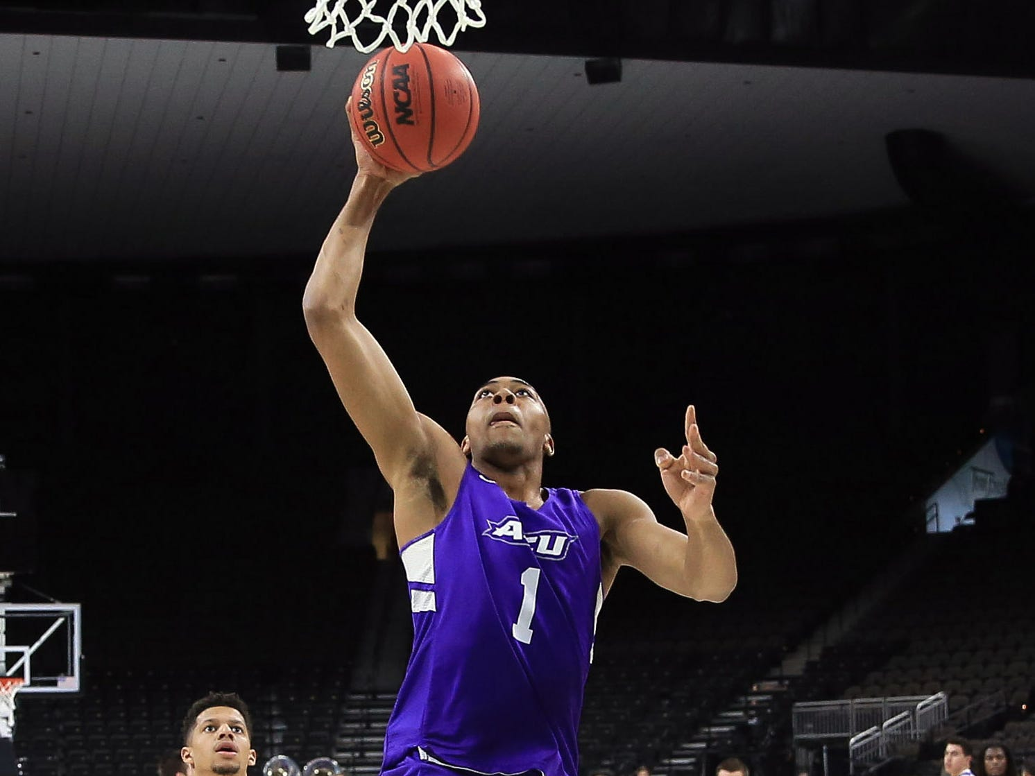 Mar 20, 2019; Jacksonville, FL, USA; Abilene Christian Wildcats forward Jaren Lewis (1) during practice day before the first round of the 2019 NCAA Tournament at Jacksonville Veterans Memorial Arena. Mandatory Credit: Matt Stamey-USA TODAY Sports