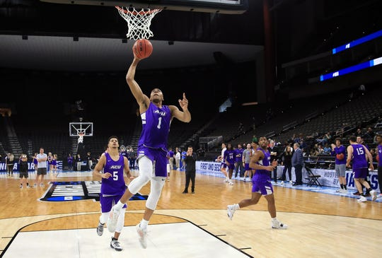 Abilene Christian Wildcats forward Jaren Lewis (1) during practice day before the first round of the 2019 NCAA Tournament at Jacksonville Veterans Memorial Arena.