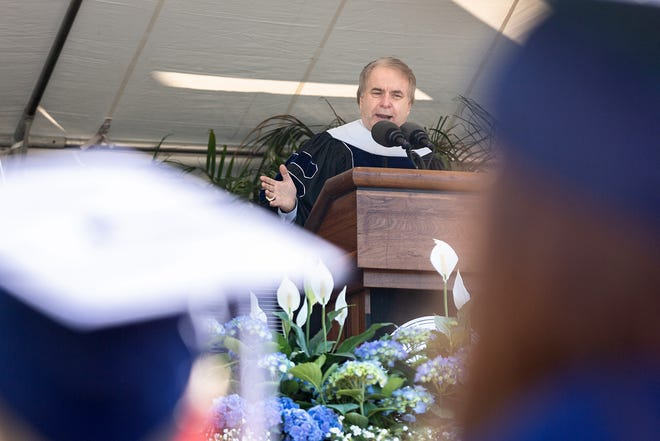 Bill Murdock speaks at the 2018 UNC Asheville graduation where he received an honorary degree from the university. He has since returned that degree.