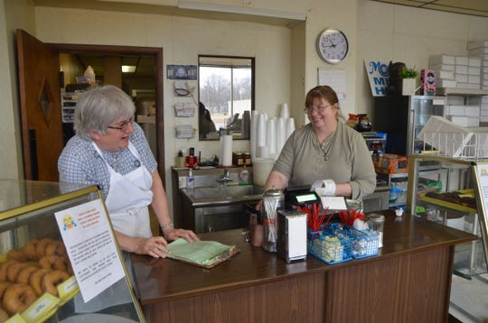 Louie's Donut Shop owner Carol Pajak and employee Laurie Palmer talk about their time working together on Wednesday, March 20, 2019. Louie's Donut Shop will be closing on or before April 30.