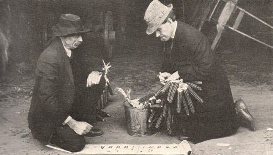 James Quinn, left, and John Barron test seed corn for germination, about 1912.