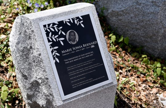 """Marie Sonia Bernard, Haiti. """"The Daughters of God never die, they just move on to a new life.""""Victims of the 2009 American Civic Association shooting are remembered at the memorial, which is located on Front and Clinton Streets in Binghamton."""