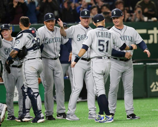 Seattle Mariners right fielder Ichiro Suzuki (51) celebrates with teammates after defeating the Oakland Athletics 9-7 in Game 1 of their Major League opening series baseball game at Tokyo Dome in Tokyo, Wednesday, March 20, 2019.