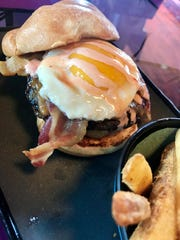 The 2 a.m. Burger at 4th Street Fillin Station comestopped with french fries, a fried egg and firecracker sauce.