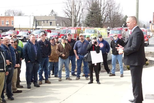 State Fire Marshal Jeff Hussey speaks to firefighters from across the county on the Crawford County Courthhouse steps Wednesday as he awards a grant for new MARCS radio equipment.
