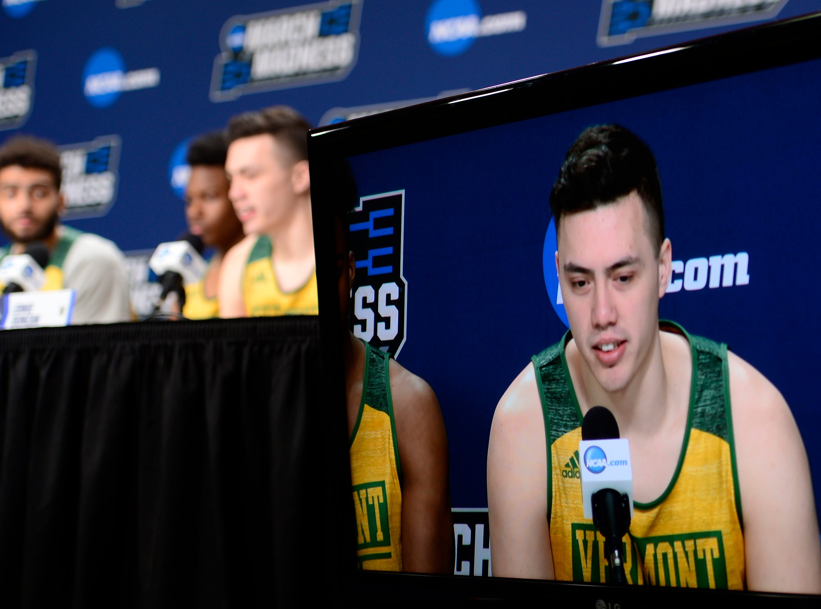 Vermont's Ernie Duncan answers a question from the media before Wednesday's NCAA tournament practice at the XL Center in Hartford, Connecticut.