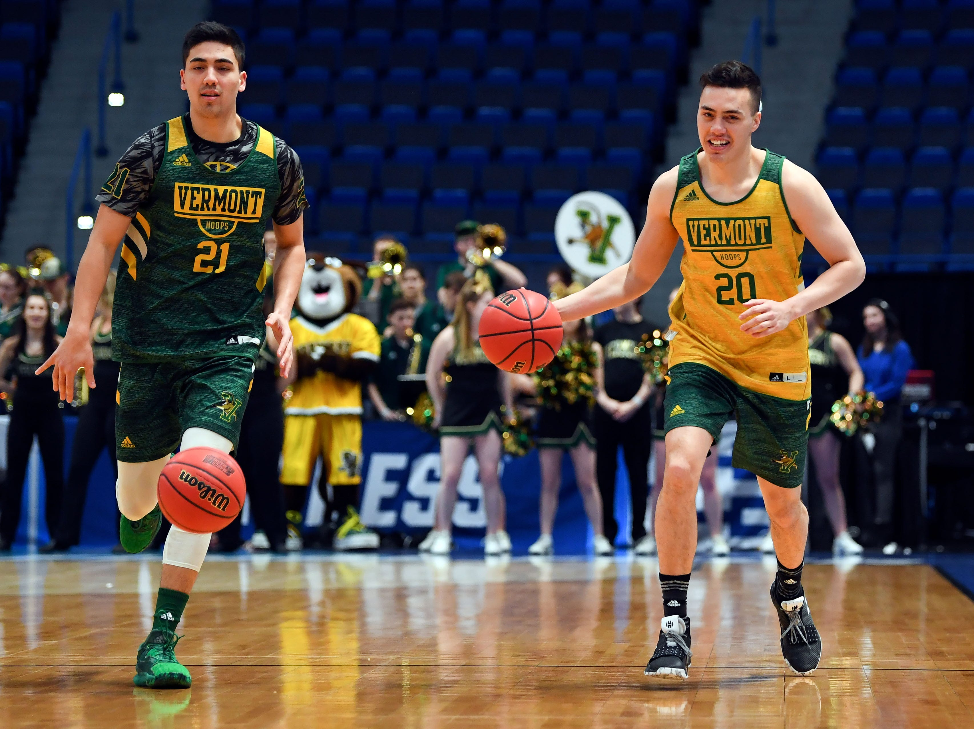 Mar 20, 2019; Hartford, CT, USA; Vermont Catamounts guard Ernie Duncan (20) and guard Everett Duncan (21) dribble the ball during practice before the first round of the 2019 NCAA Tournament at XL Center. Mandatory Credit: Robert Deutsch-USA TODAY Sports
