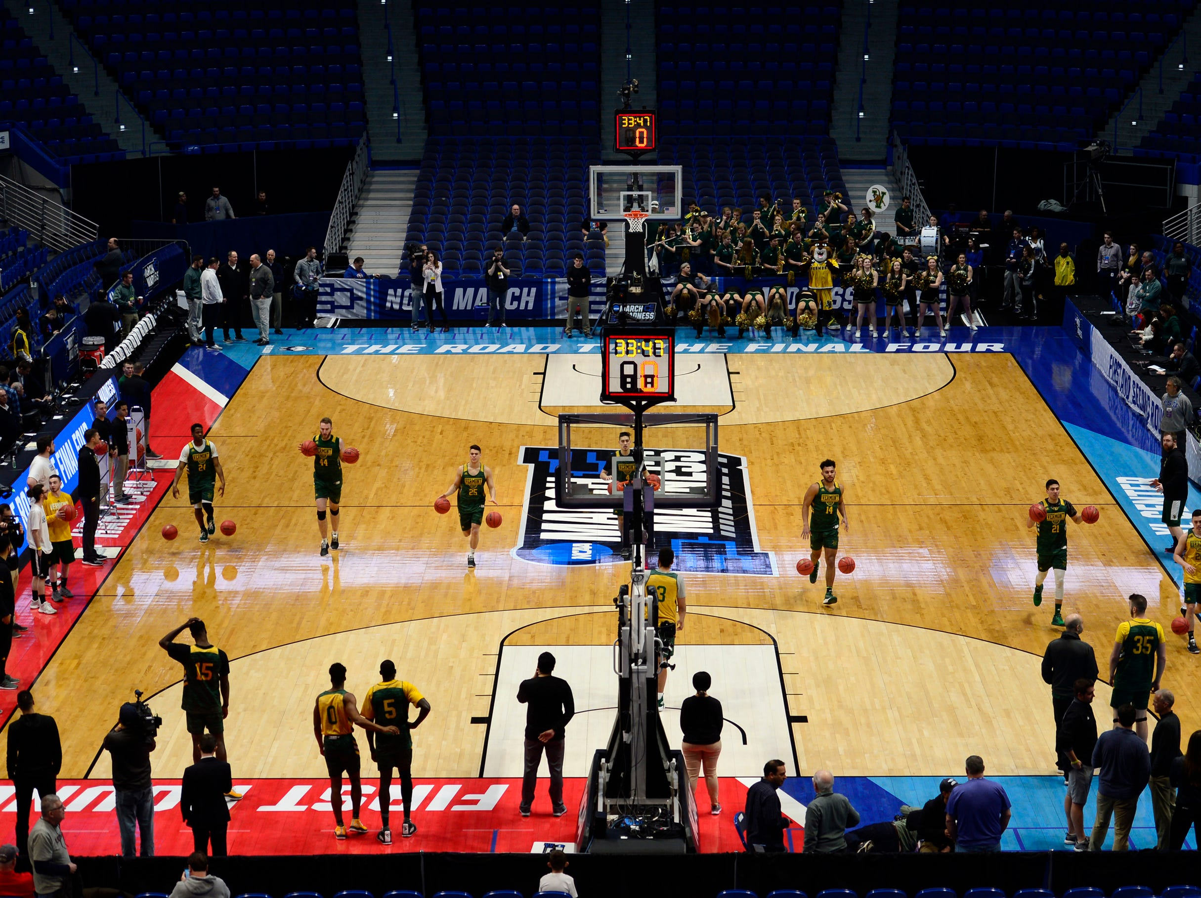 The University of Vermont men's basketball team warms up for its practice at the XL Center on Wednesday in Hartford, Connecticut.