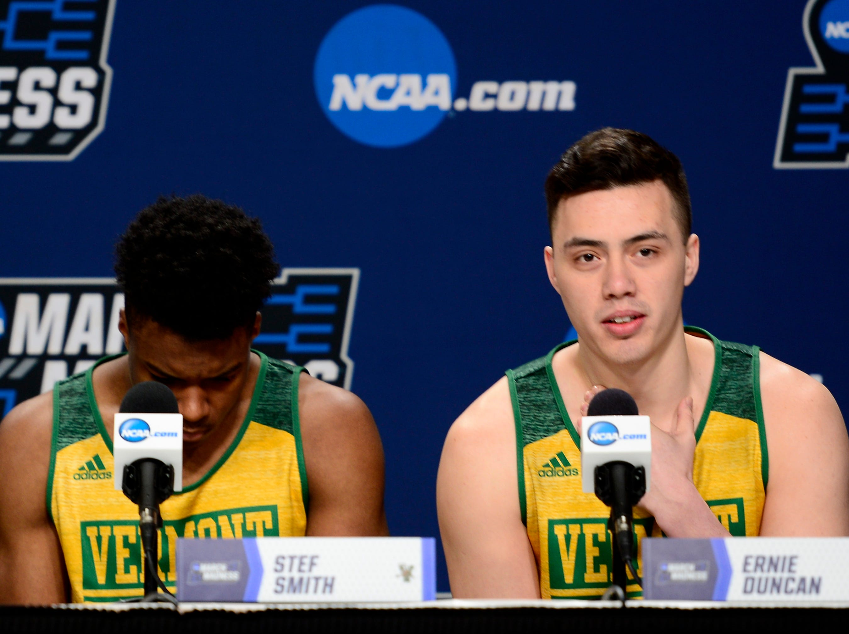Vermont's Ernie Duncan, right, answers a question from the media before Wednesday's NCAA tournament practice at the XL Center in Hartford, Connecticut.