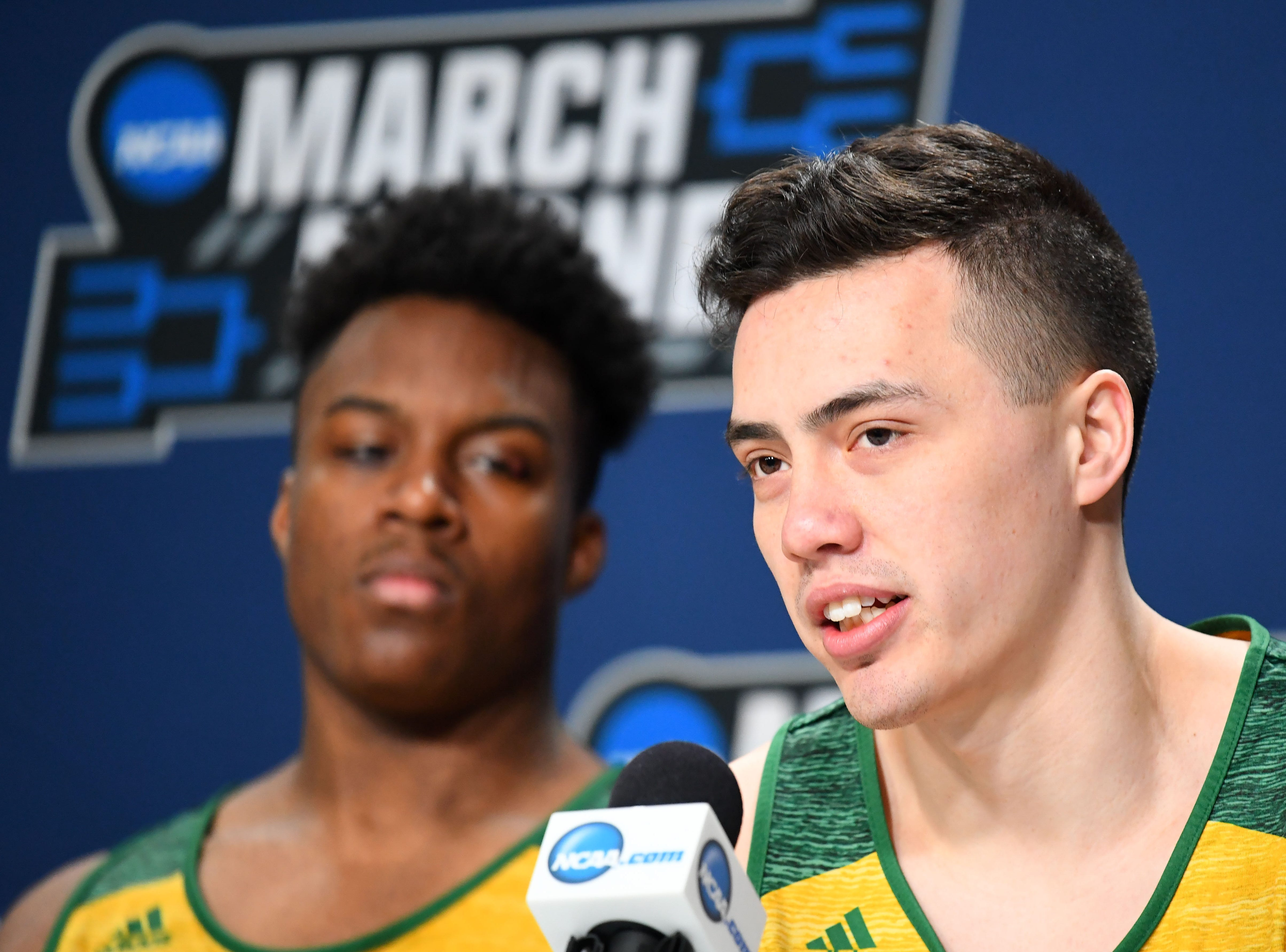 Mar 20, 2019; Hartford, CT, USA; Vermont Catamounts guard Ernie Duncan (20) speaks with the media before a practice in the first round of the 2019 NCAA Tournament at XL Center. Mandatory Credit: Robert Deutsch-USA TODAY Sports