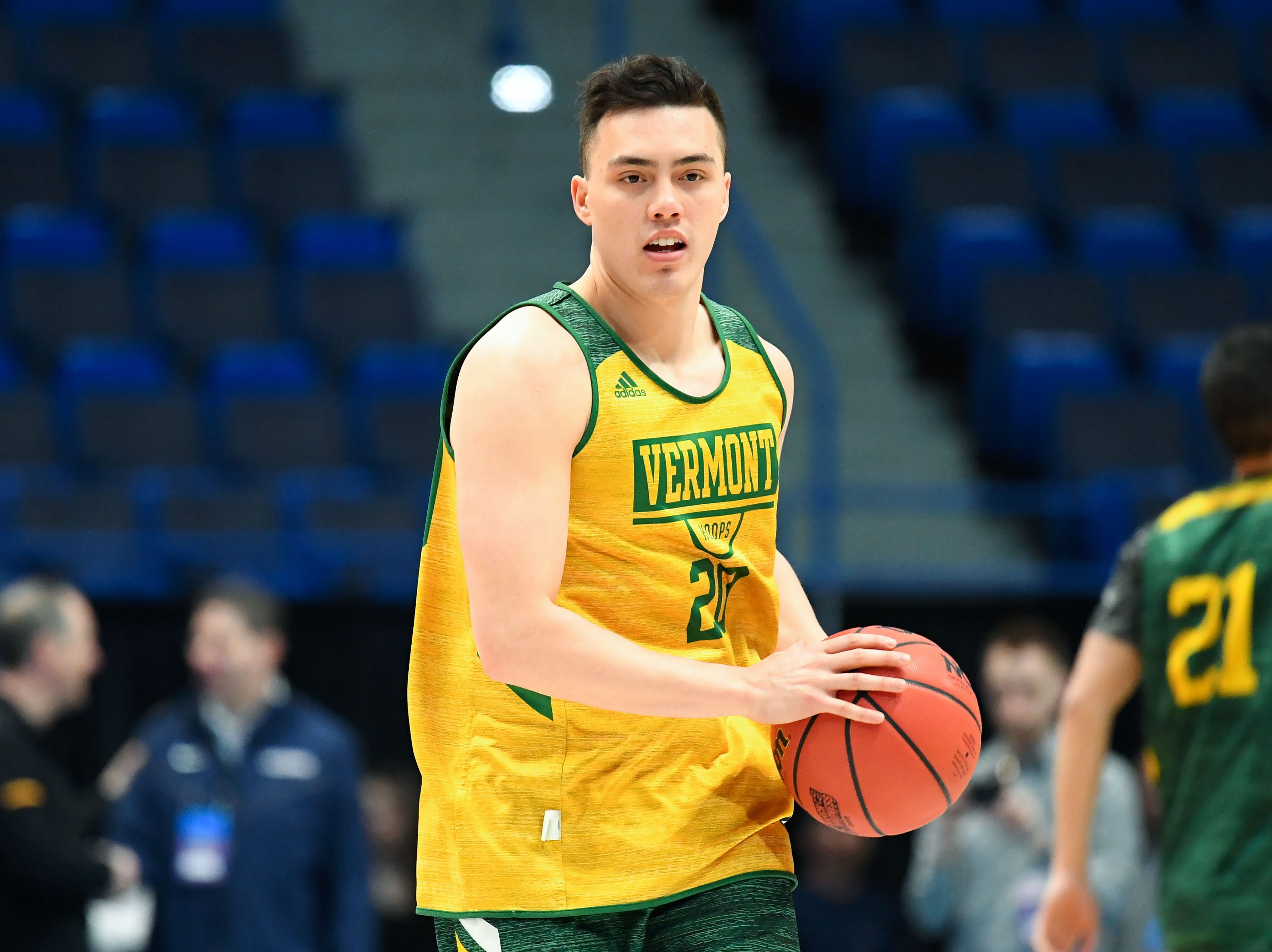 Mar 20, 2019; Hartford, CT, USA; Vermont Catamounts guard Ernie Duncan (20) passes the ball during practice before the first round of the 2019 NCAA Tournament at XL Center. Mandatory Credit: Robert Deutsch-USA TODAY Sports