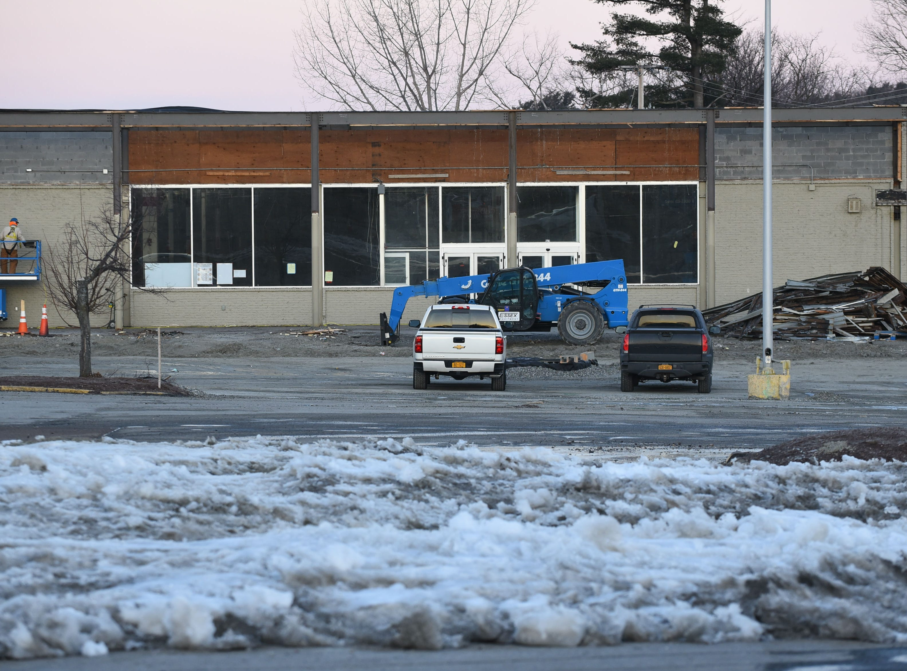 The portico over the main entrance to the form Kmart in South Burlington has been removed, as seen on the morning of Wednesday, March 20, 2019. Renovation work has begun at the empty shopping center to make way for a new Hannaford supermarket.