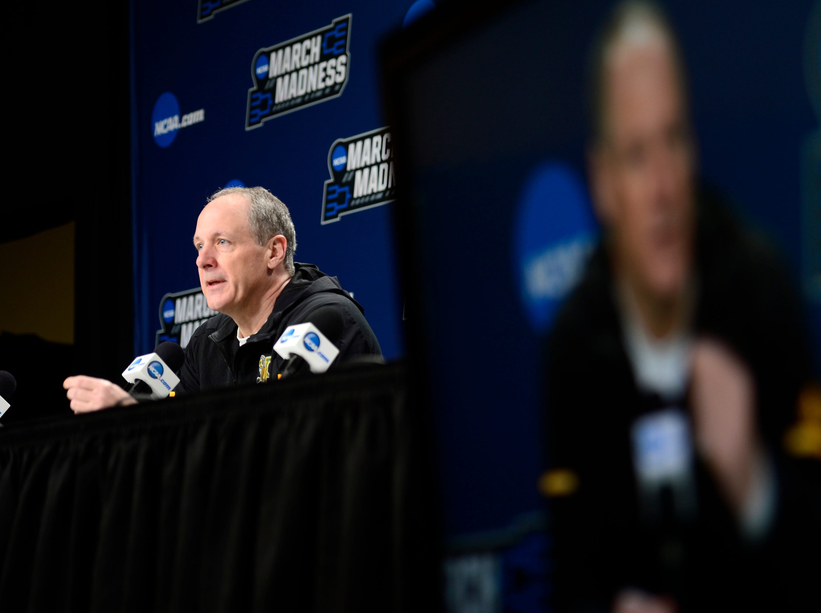 Vermont head coach John Becker speaks to the media on Wednesday ahead of the Catamounts' NCAA tournament game at the XL Center in Hartford, Connecticut.