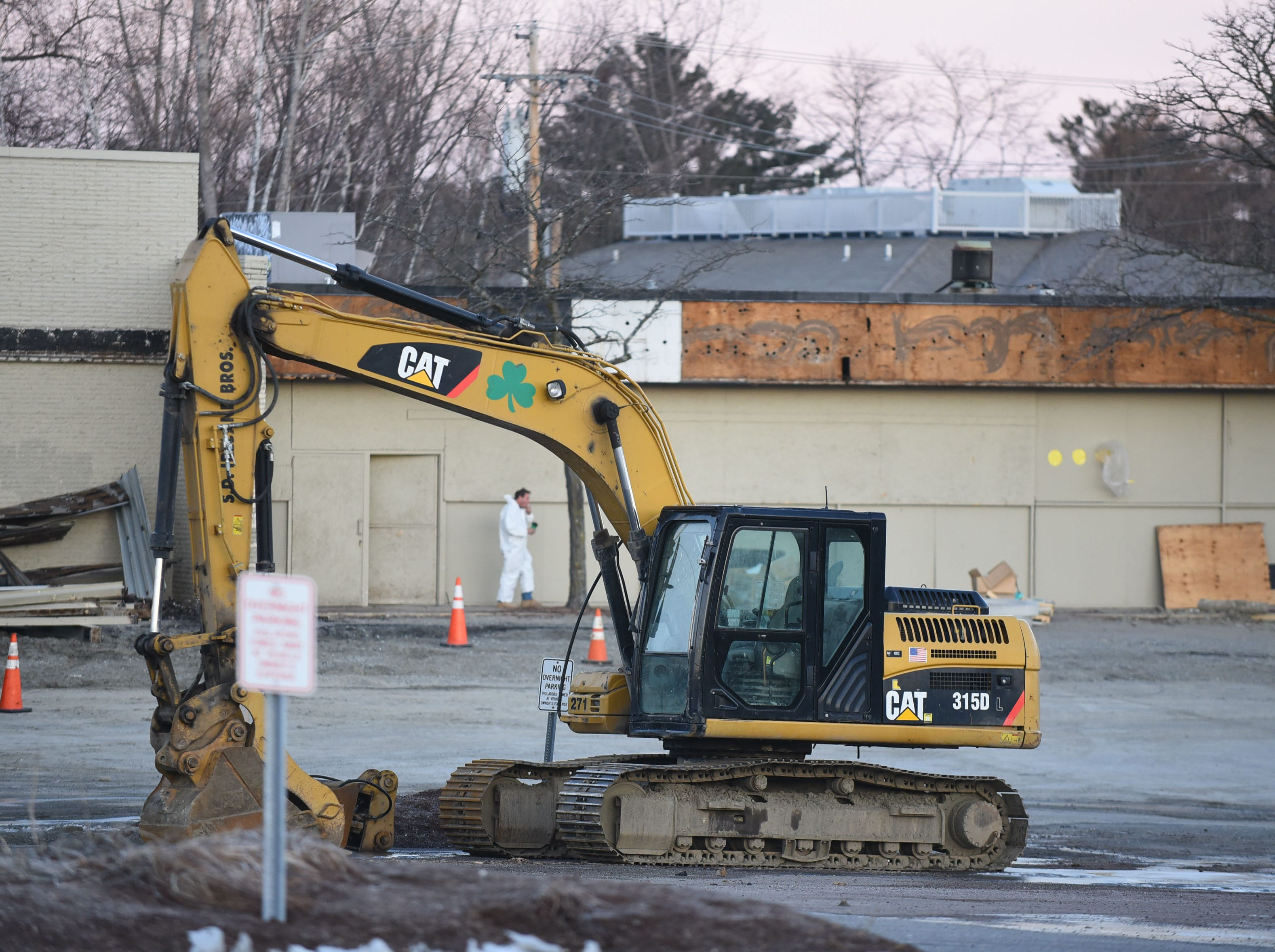 Equipment stands ready in the parking lot of the former Kmart in South Burlington  on the morning of Wednesday, March 20, 2019. Work has begun at the empty shopping center to make way for a new Hannaford supermarket.