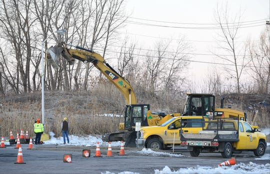 Workers remove a lamp post from the parking area of the former Kmart Plaza off Shelburne Road in South Burlington on the morning of Wednesday, March 20, 2019. Renovation work has begun at the empty shopping center to make way for a new Hannaford supermarket.