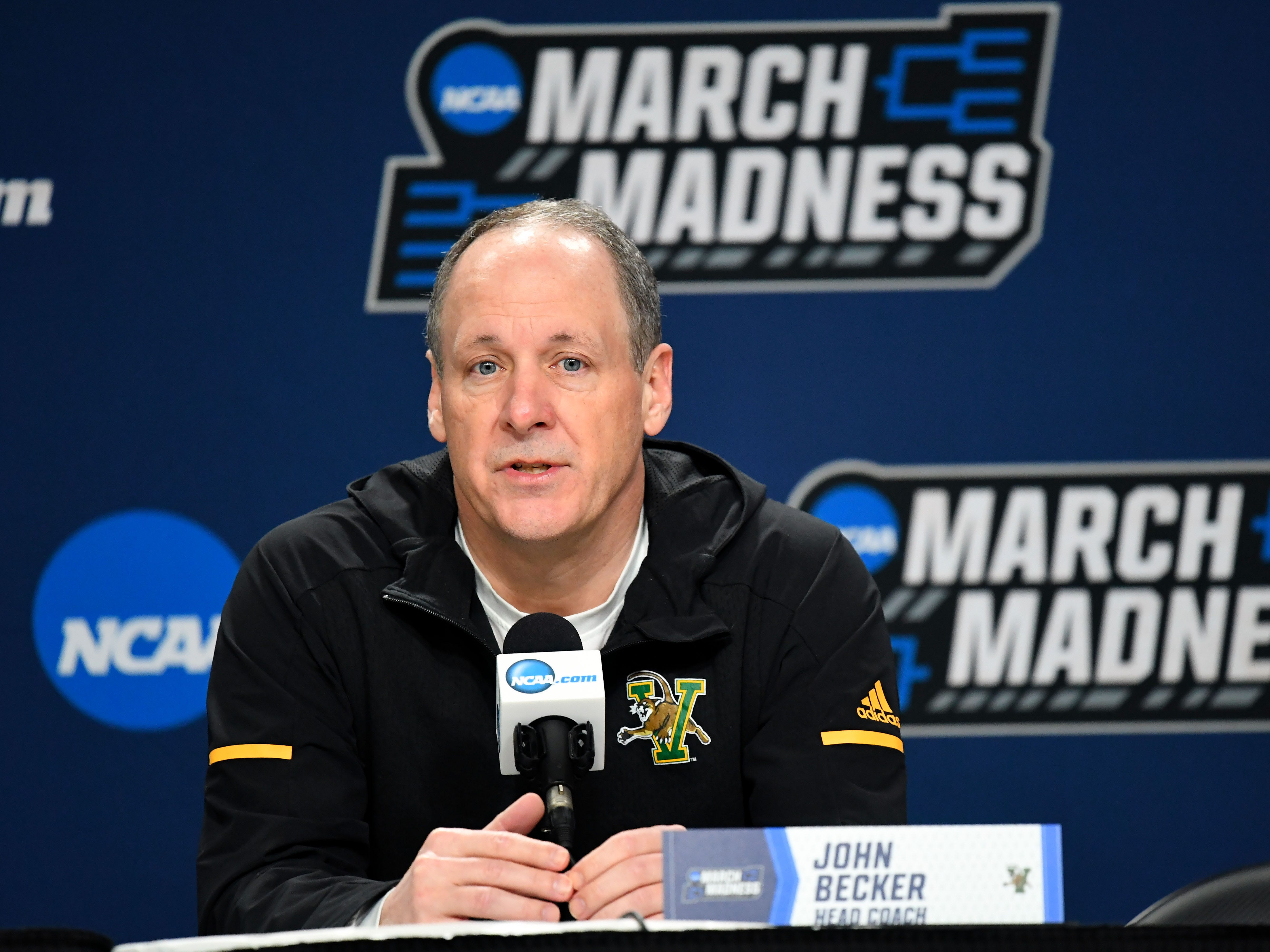 Mar 20, 2019; Hartford, CT, USA; Vermont Catamounts head coach John Becker speaks with the media before a practice in the first round of the 2019 NCAA Tournament at XL Center. Mandatory Credit: Robert Deutsch-USA TODAY Sports