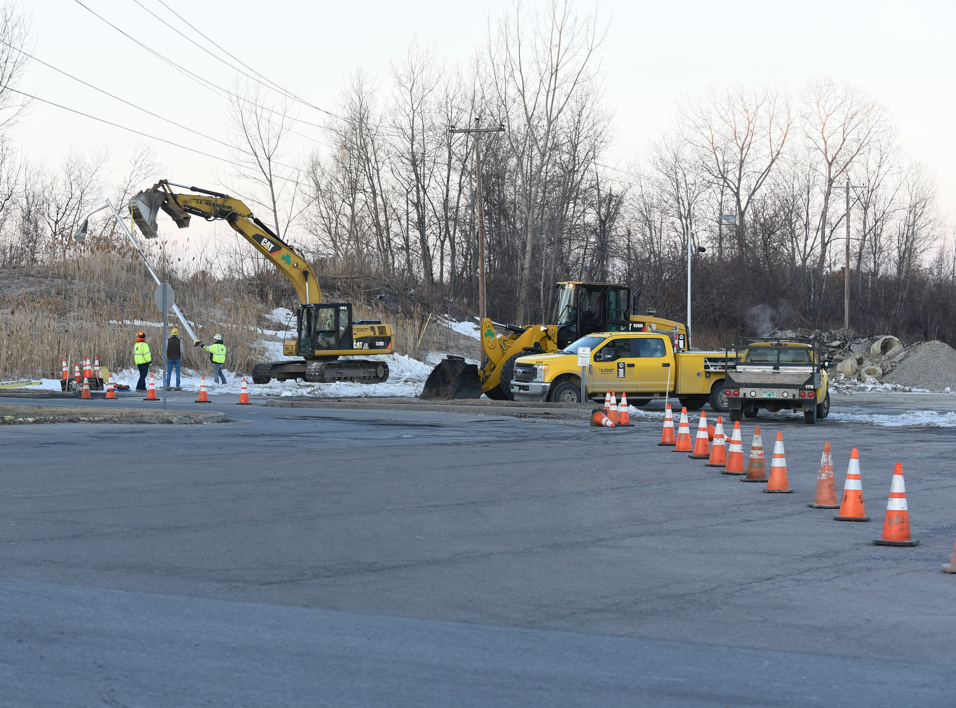 Orange cones close off the parking lot to the shopping center off of Shelburne Road in South Burlington that housed the Kmart as workers remove a lamp post on the morning of Wednesday, March 20, 2019. Work has begun at the empty shopping center to make way for a new Hannaford supermarket.