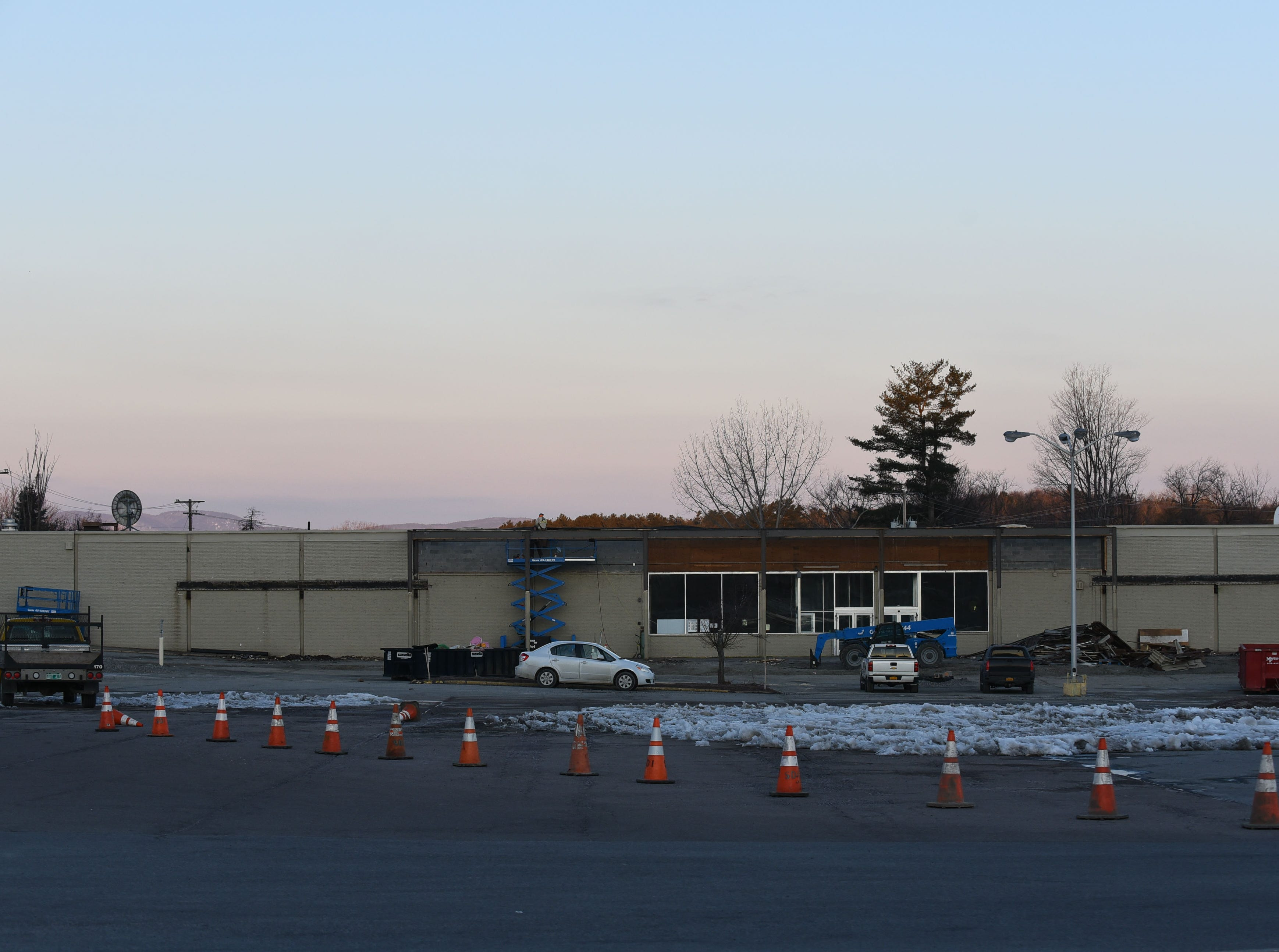Orange cones close off the parking lot to the shopping center off of Shelburne Road in South Burlington that housed the Kmart on the morning of Wednesday, March 20, 2019. Work has begun at the empty shopping center to make way for a new Hannaford supermarket.