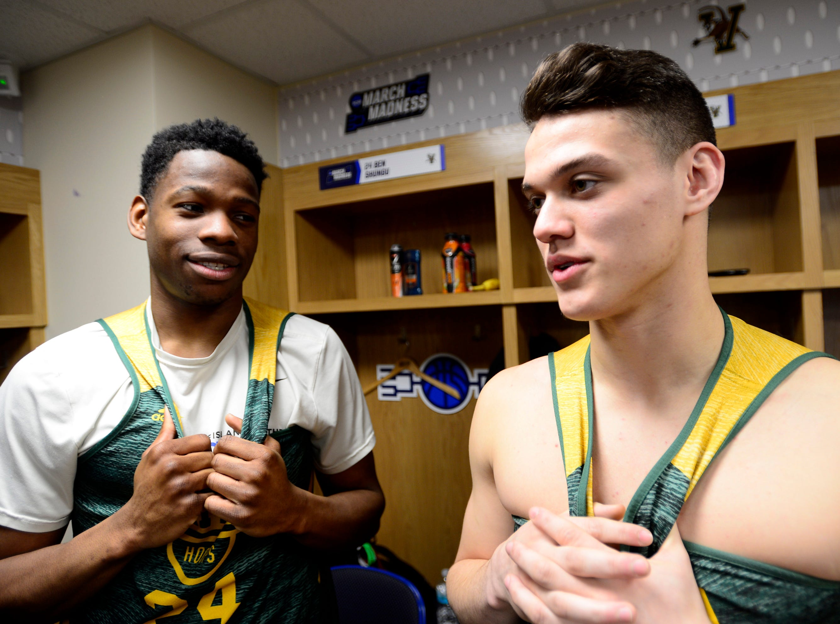Vermont's Ben Shungu, left, and Kevin Garrison sit for an interview before their practice Wednesday at the XL Center in Hartford, Connecticut.