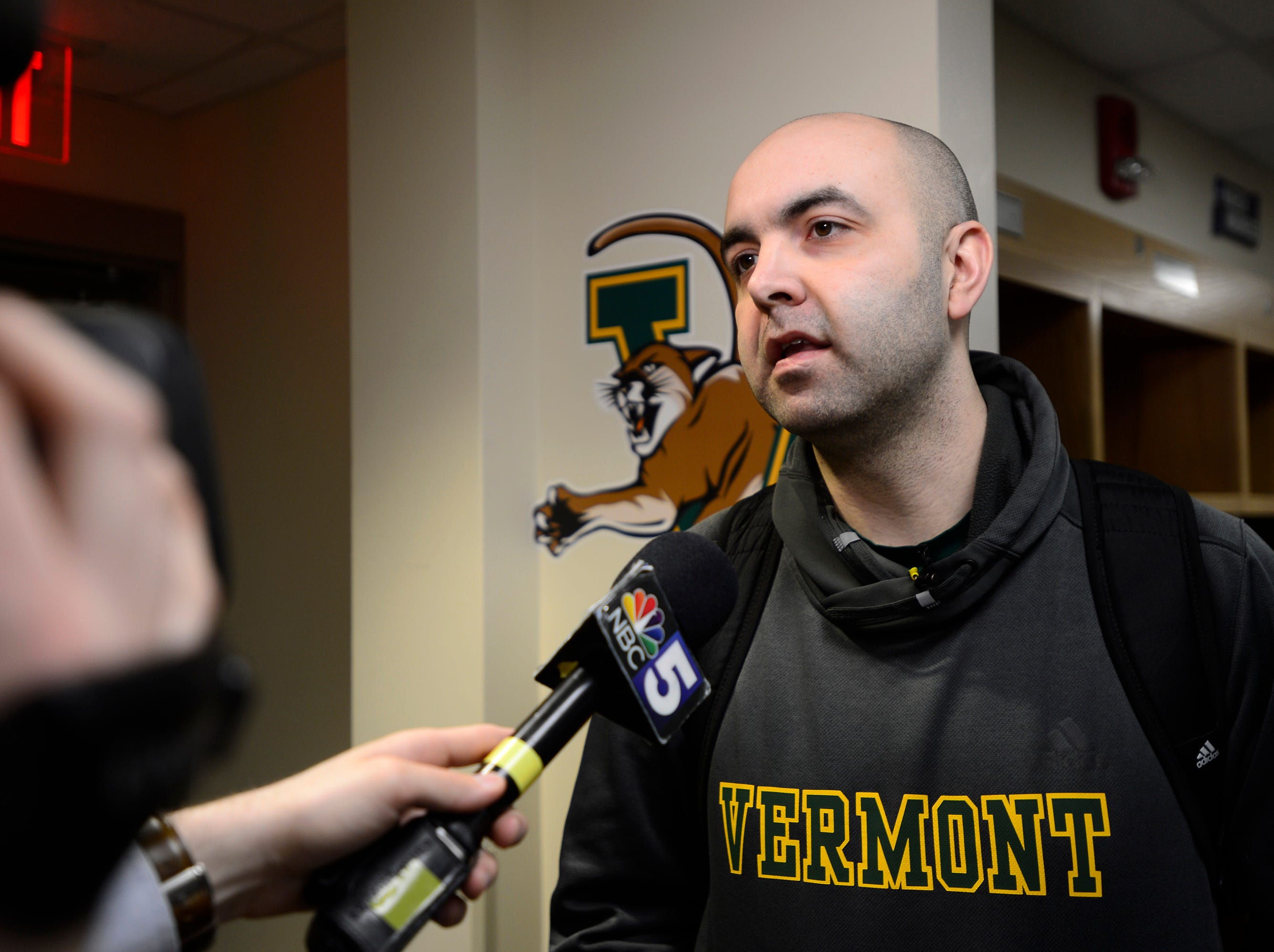 Vermont assistant coach Kyle Cieplicki answers a question in the locker room before the Catamounts' practice Wednesday at the XL Center in Hartford, Connecticut.