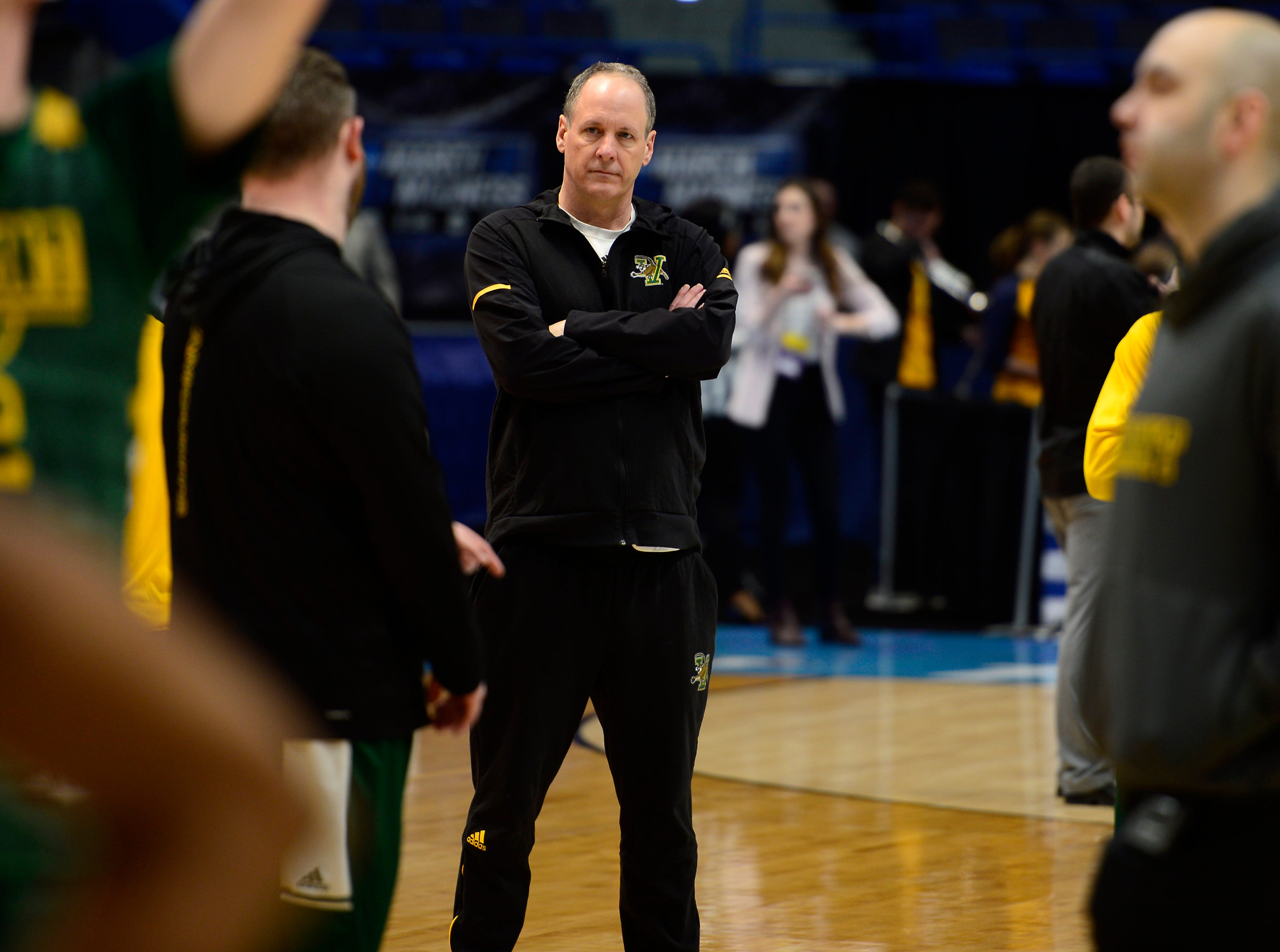 Vermont head coach John Becker watches his team practice Wednesday ahead of the Catamounts' NCAA tournament game at the XL Center in Hartford, Connecticut.