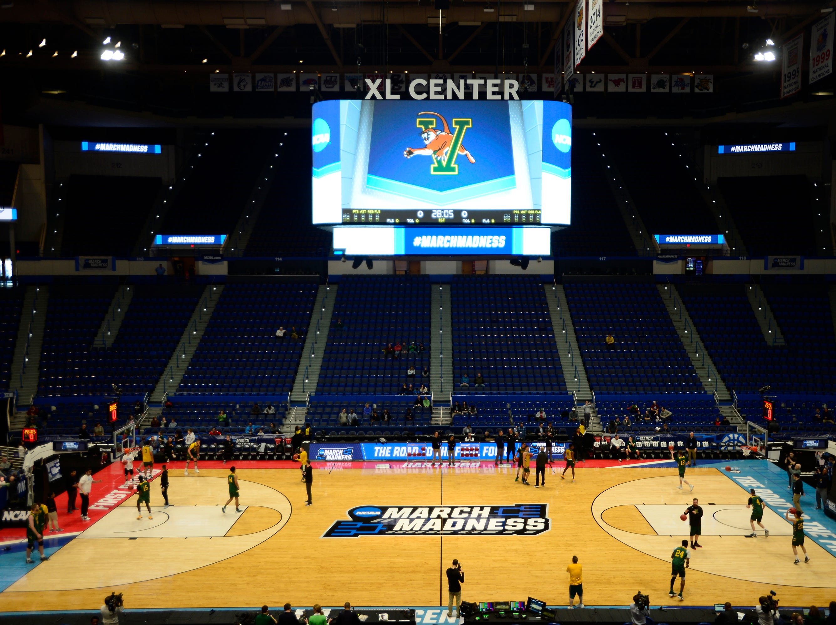 The University of Vermont men's basketball team practices at the XL Center on Wednesday ahead of its NCAA tournament game against Florida State in Hartford, Connecticut.