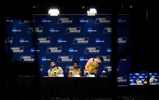 Vermont's Anthony Lamb, left, Stef Smith and Ernie Duncan leave a press conference before Wednesday's NCAA tournament practice at the XL Center in Hartford, Connecticut.
