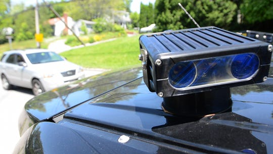 A license plate is scanned using a license plate reader that is mounted on the roof of a law enforcement vehicle. (Desert Sun file photo)