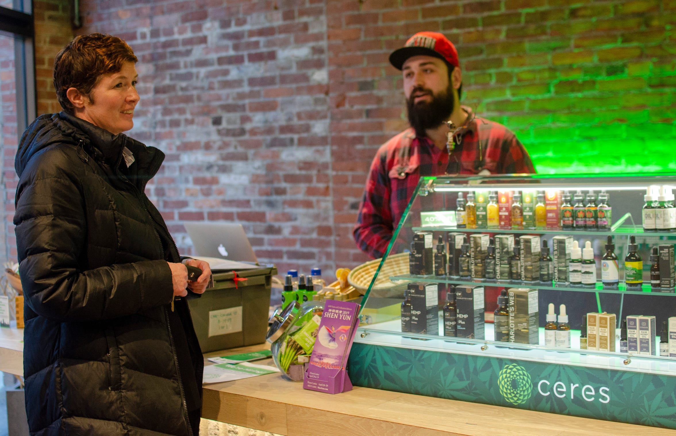 Bridget Conry, left, ends her day with a visit to the Ceres Natural Remedies store in Burlington.