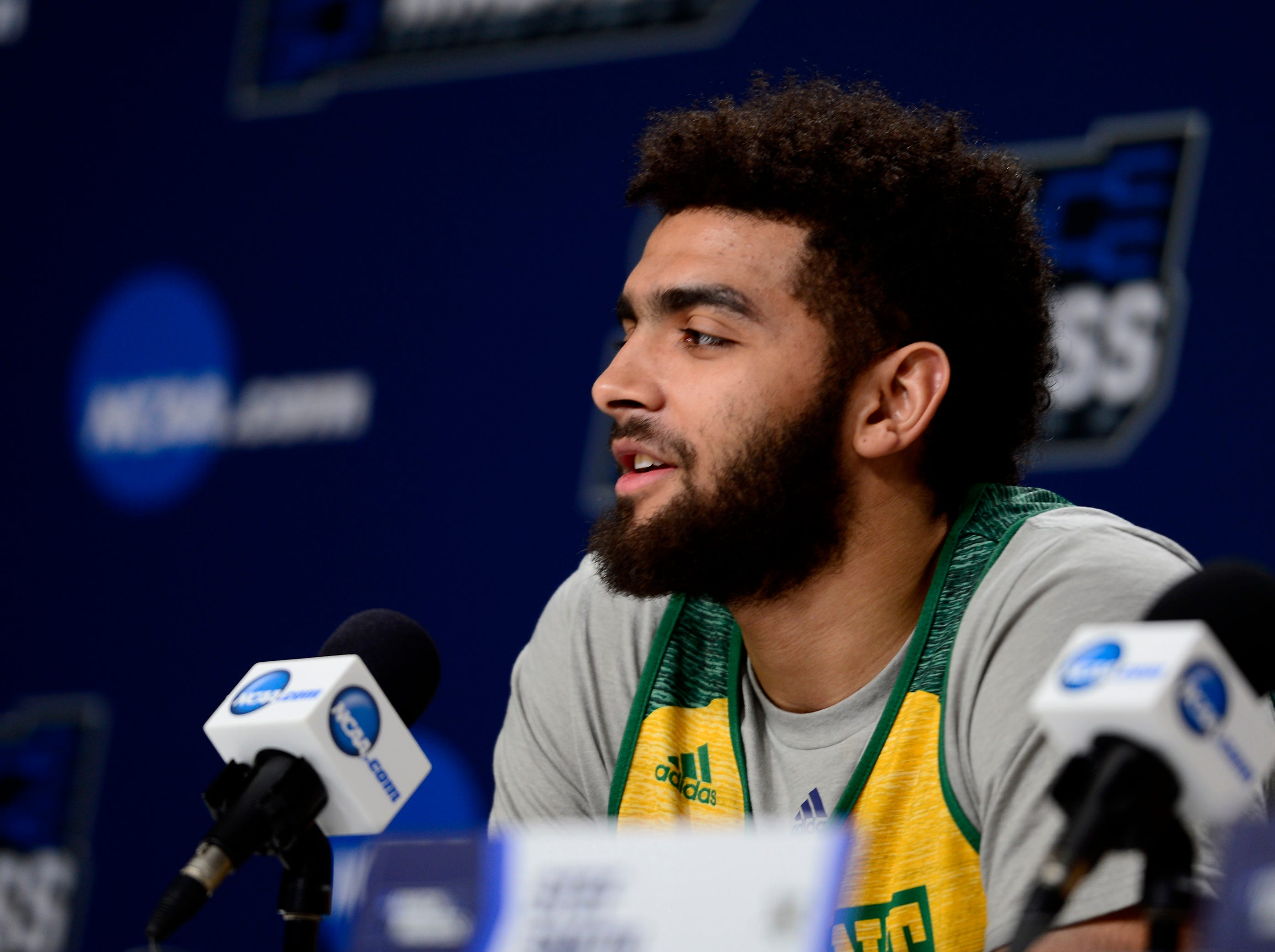 Vermont's Anthony Lamb responds to a question from the media before Wednesday's NCAA tournament practice at the XL Center in Hartford, Connecticut.