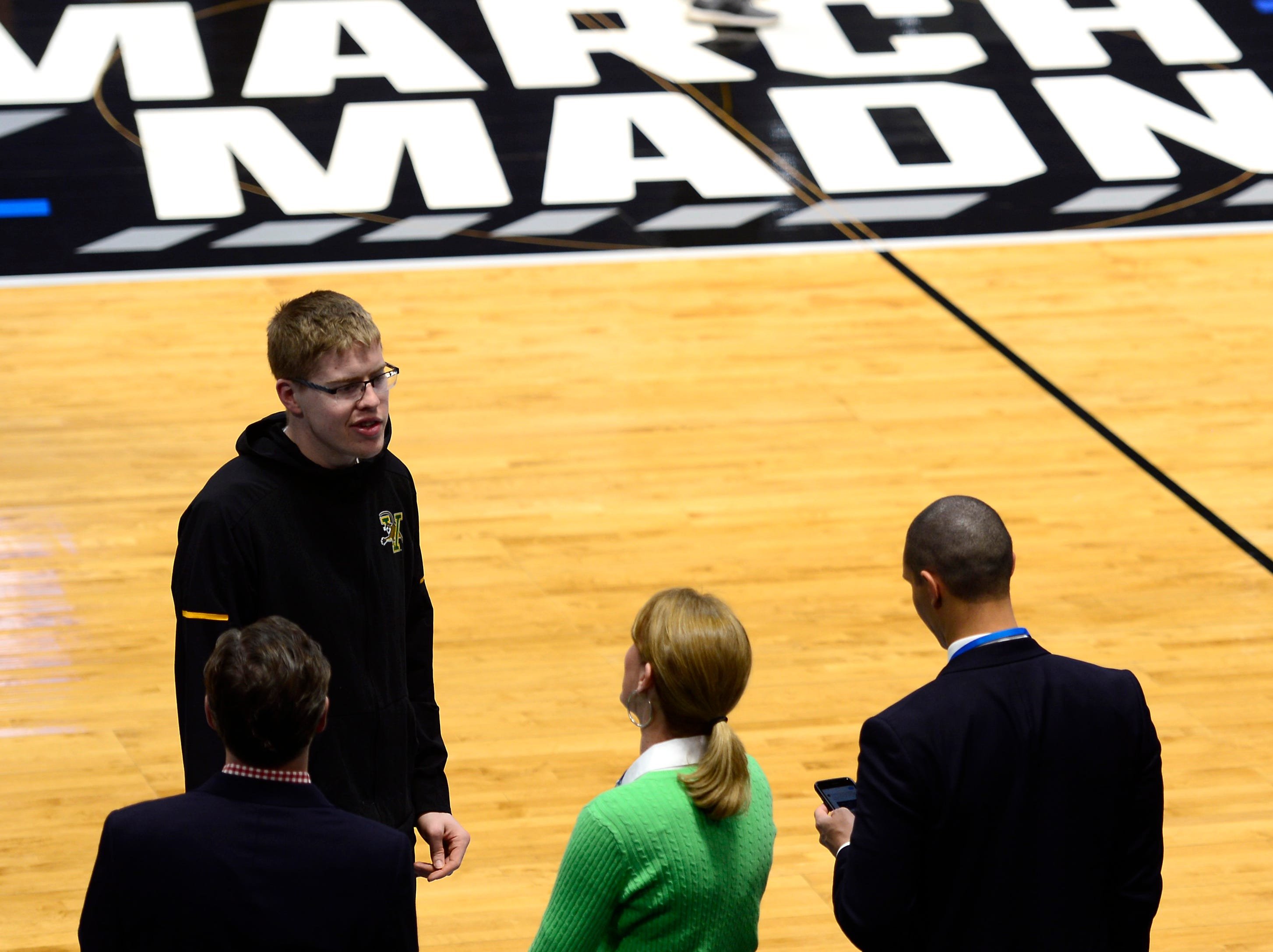 Vermont's Josh Speidel talks to onlookers at practice on Wednesday ahead of the Catamounts' NCAA tournament game at the XL Center in Hartford, Connecticut.