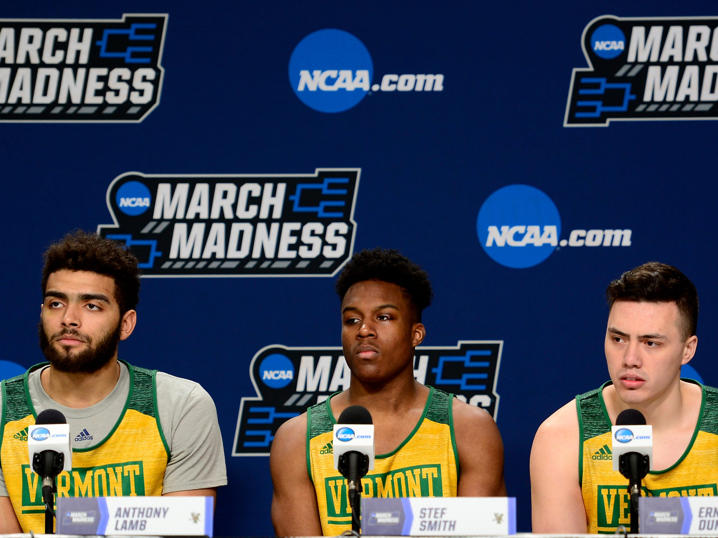 Vermont's Anthony Lamb, left, Stef Smith and Ernie Duncan answer questions from the media before Wednesday's NCAA tournament practice at the XL Center in Hartford, Connecticut.