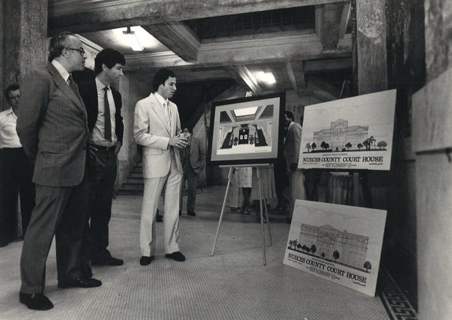 Architects Maurice Finegold (left) and Paul Curtis (center) with Anderson Notter Finegold Inc. along with Charles Bennett (right) present plans to repurpose the 1914 Nueces County Courthouse on April 24, 1980. The plans included office space and a jail-themed restaurant on the top floor.
