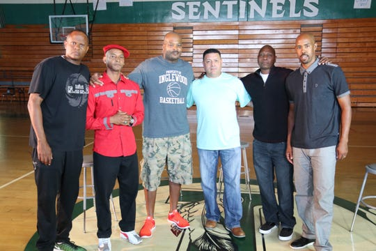 "Inglewood (California) Police Lt. Scott Collins (center, light green shirt), is shown during filming of the documentary ""Inglewood Morning Sessions."" The other men include:  Coach Pat Roy (far left), Carlo Calhoun, Ralph Shelton, Sam Turks and Jason Crowe, who were involved with the early-morning basketball camp run by Collins, which mentored area youth. South Jersey native Patricia Pawlak is a producer on the film."