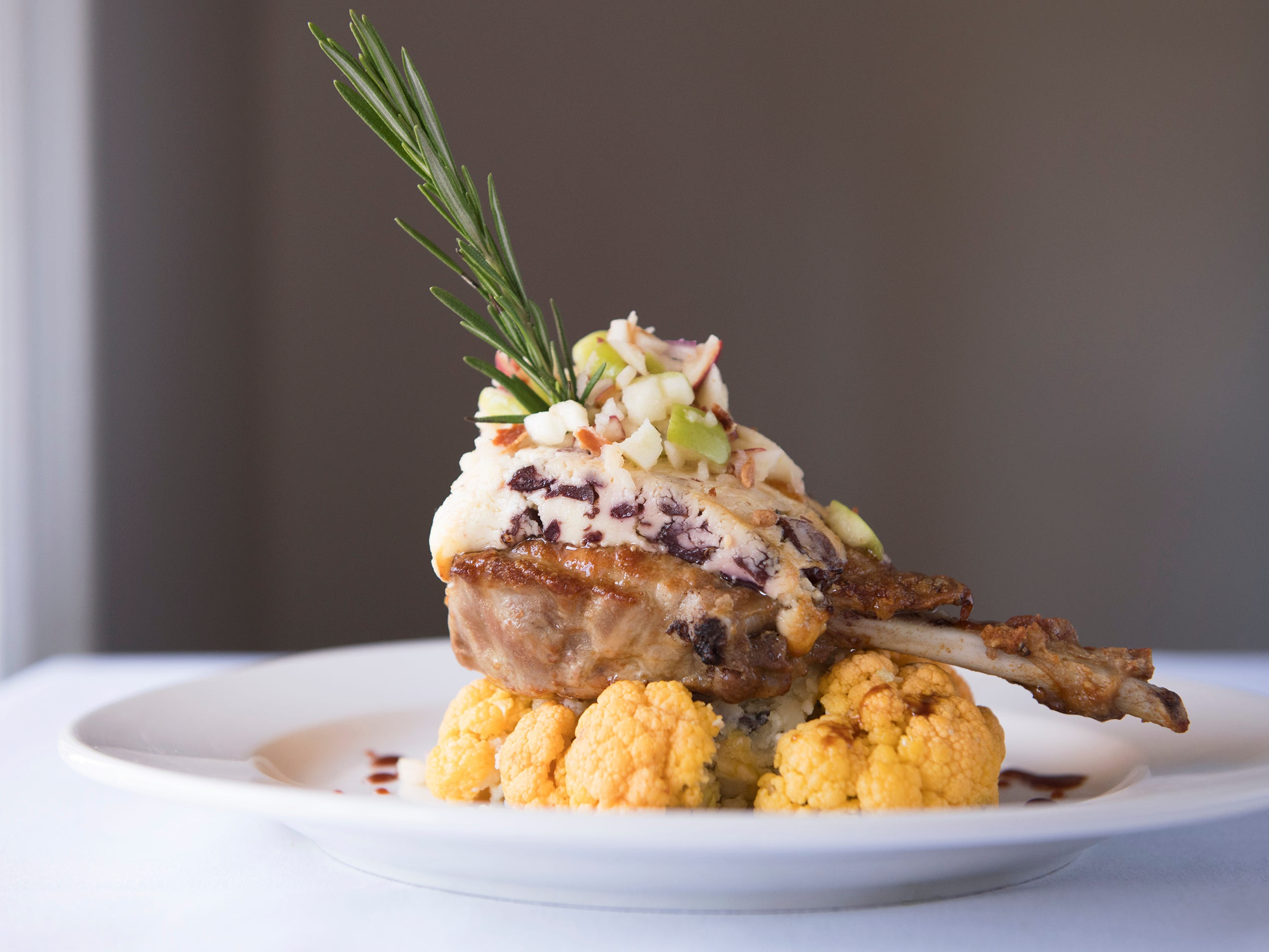 Berkshire pork chop with apple-bacon salsa and Quoxein Farms cranberry Stilton is an entree option on the SJ Hot Chefs' Spring Restaurant Week menu of Braddock's in Medford.