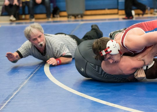 Zane Trace senior Jordan Hoselton received his 100th pin win against Miami Trace's Graham Carson at the 2019 Division II southeast sectional tournament at Washington Courthouse.