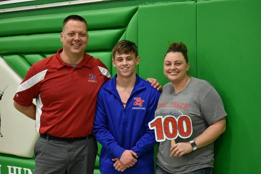 Zane Trace senior Jordan Hoselton, middle, celebrates getting his 100th win with his parents Bob and Jamie Hoselton at the 2018 SVC wrestling championships in 2018.
