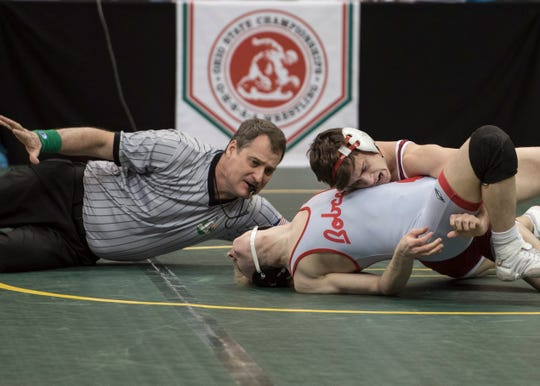 Zane Trace's Jordan Hoselton wrestles Bowling Green's August Eschedor at 132 during the first day of the OHSAA state wrestling tournament at the Schottenstein Center. Hoselton won his match.