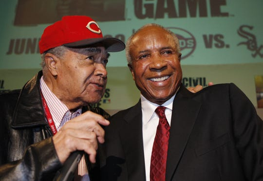 Cincinnati Reds Hall of Famers Chuck Harmon, left, and Frank Robinson joke with one another during a press conference held at the Cincinnati Reds Hall of Fame Museum in 2009. Both men died in 2019.