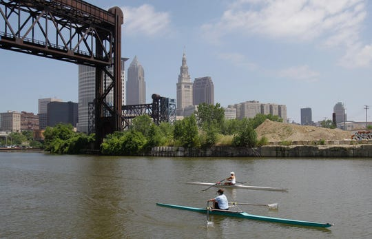 FILE: In this July 12, 2011, file photo, two rowers paddle along the Cuyahoga River in Cleveland.
