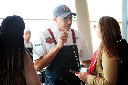 Gary Davis, executive chef of Great American Ball Park, talks with reporters during the 2019 Media Day Tasting event held at the ball park on March 20, 2019. Davis is  local to Cincinnati, he went to high school at Purcell Marian, where he played baseball (pitcher and shortstop), trained at Johnson & Wales, learned a lot under Todd Kelly at Orchids, then went on to be banquet chef, then executive chef at Jack Casino.