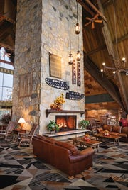 Hueston Woods Lodge boasts a big electric fireplace that turns on the cozy with the flip of a switch and plenty of squashy couches.
