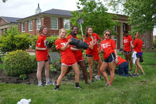 "Volunteers ""Plant the Campus Red"" at the annual campus beautification event on Thursday, April 20, 2017. (Beth Lowary, APSU)"