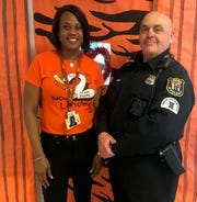 Chabak2: Officer Ed Chabak (right) with School No. 2 Principal Atiya Perkins.