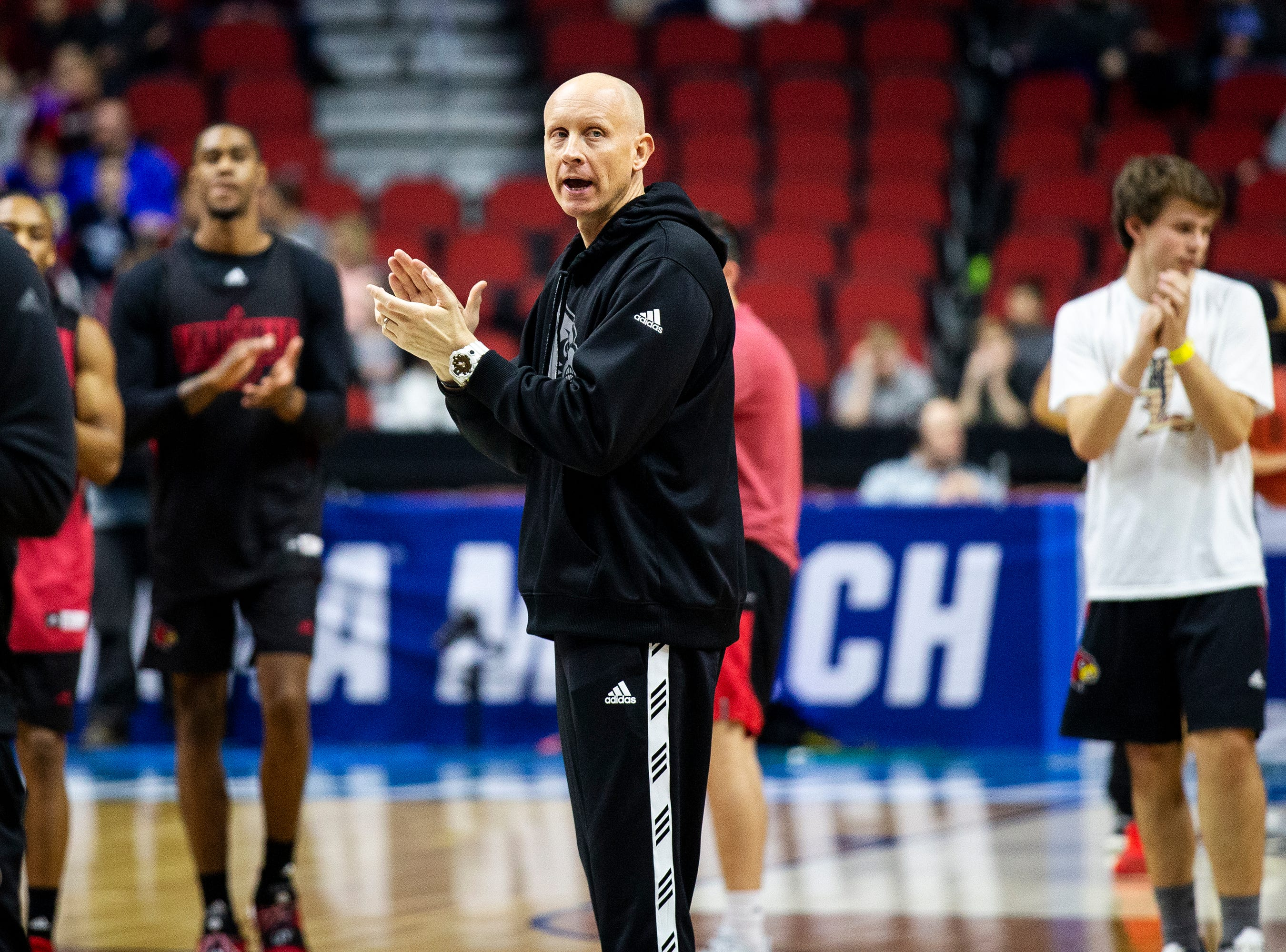 Louisville Head Coah Chris Mack calls the team over to a huddle during Louisville's open practice before the first round of the NCAA Men's Basketball Tournament on Wednesday, March 20, 2019, at Wells Fargo Arena in Des Moines, Iowa.