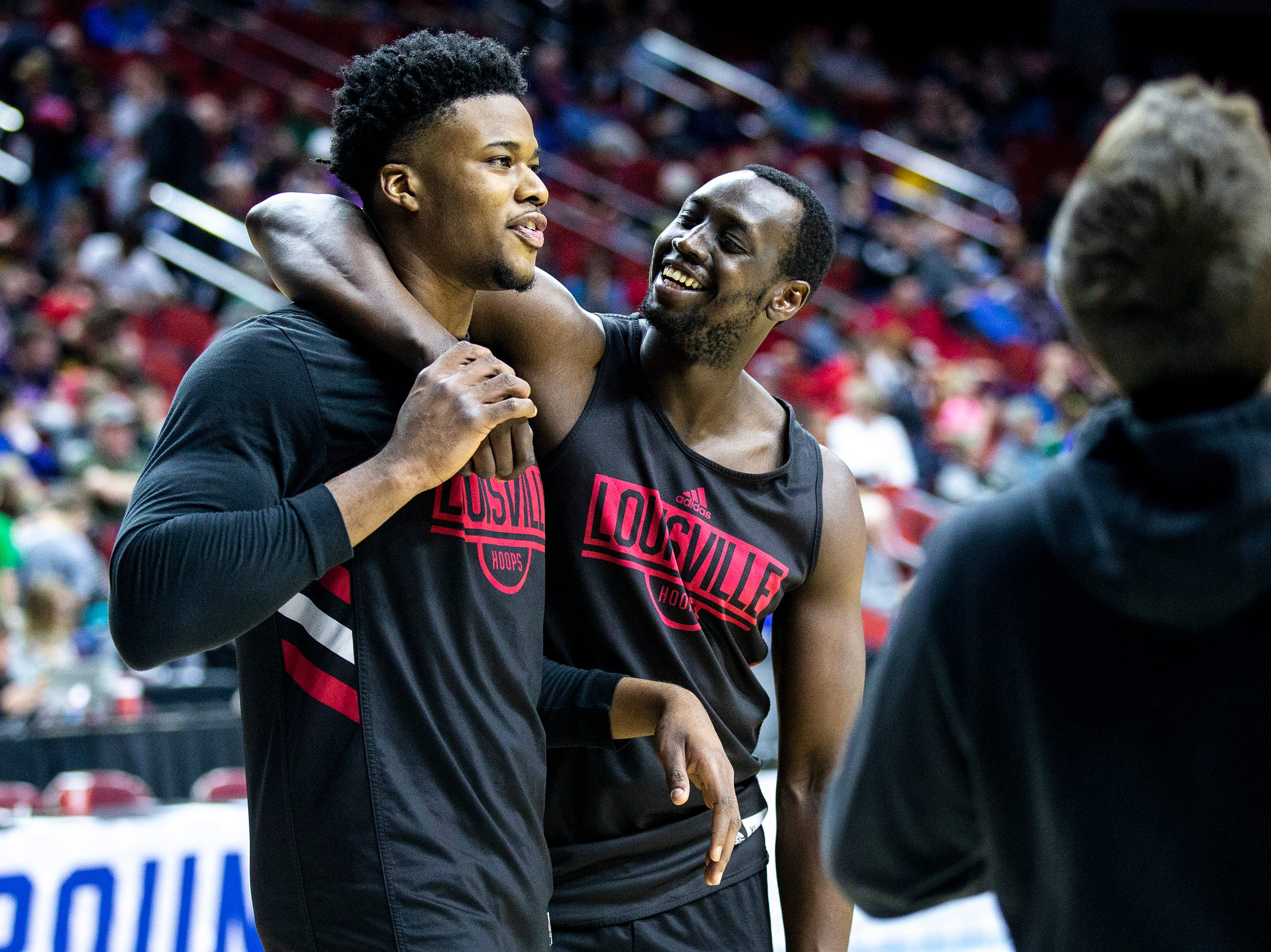 Louisville's Akoy Agau and Steven Enoch laugh between practice drills during Louisville's open practice before the first round of the NCAA Men's Basketball Tournament on Wednesday, March 20, 2019, at Wells Fargo Arena in Des Moines, Iowa.