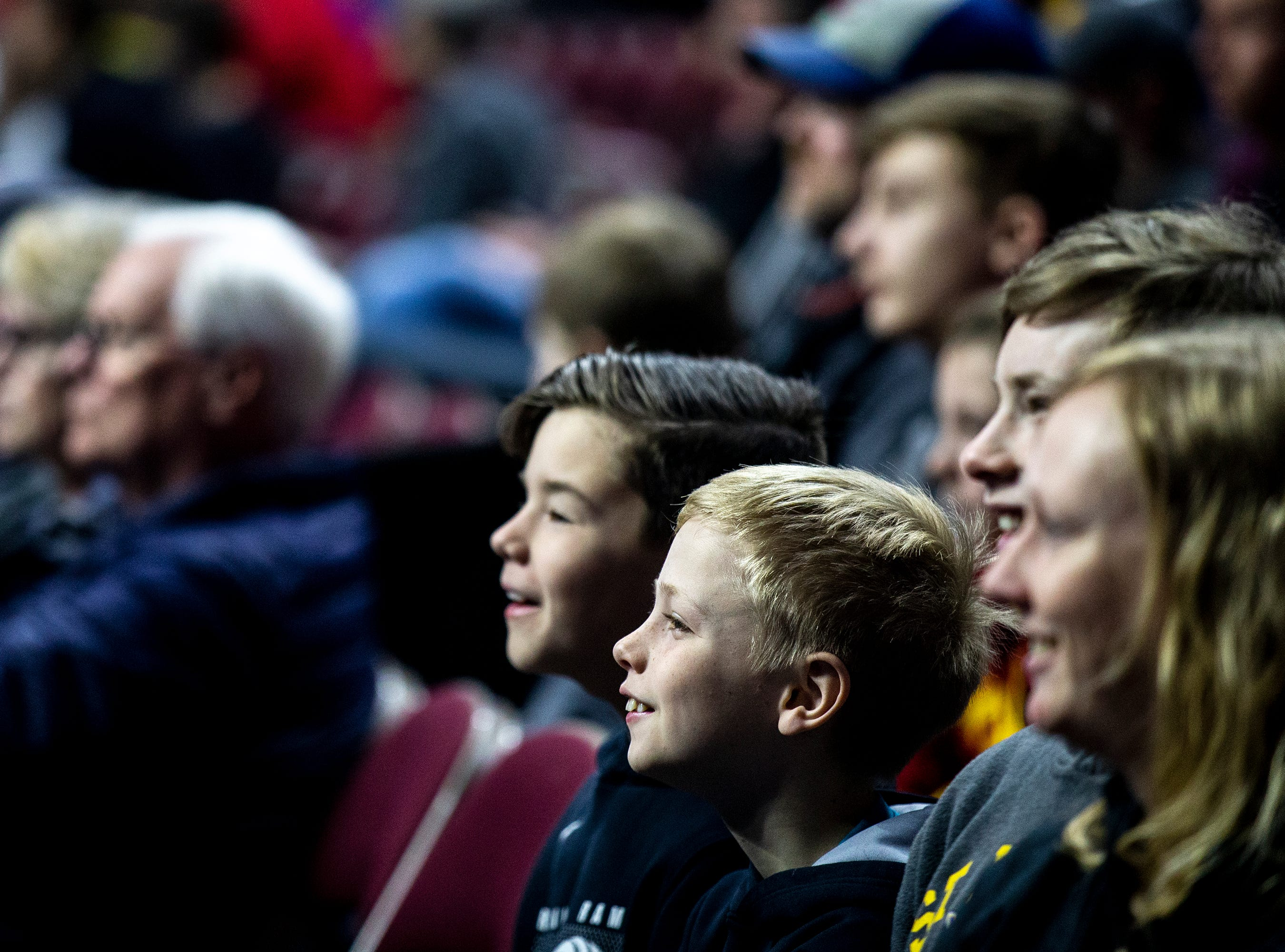 Young basketball fans watch from the stands during Minnesota's open practice before the first round of the NCAA Men's Basketball Tournament on Wednesday, March 20, 2019, at Wells Fargo Arena in Des Moines, Iowa. Minnesota will face Louisville in the first round on Thursday.
