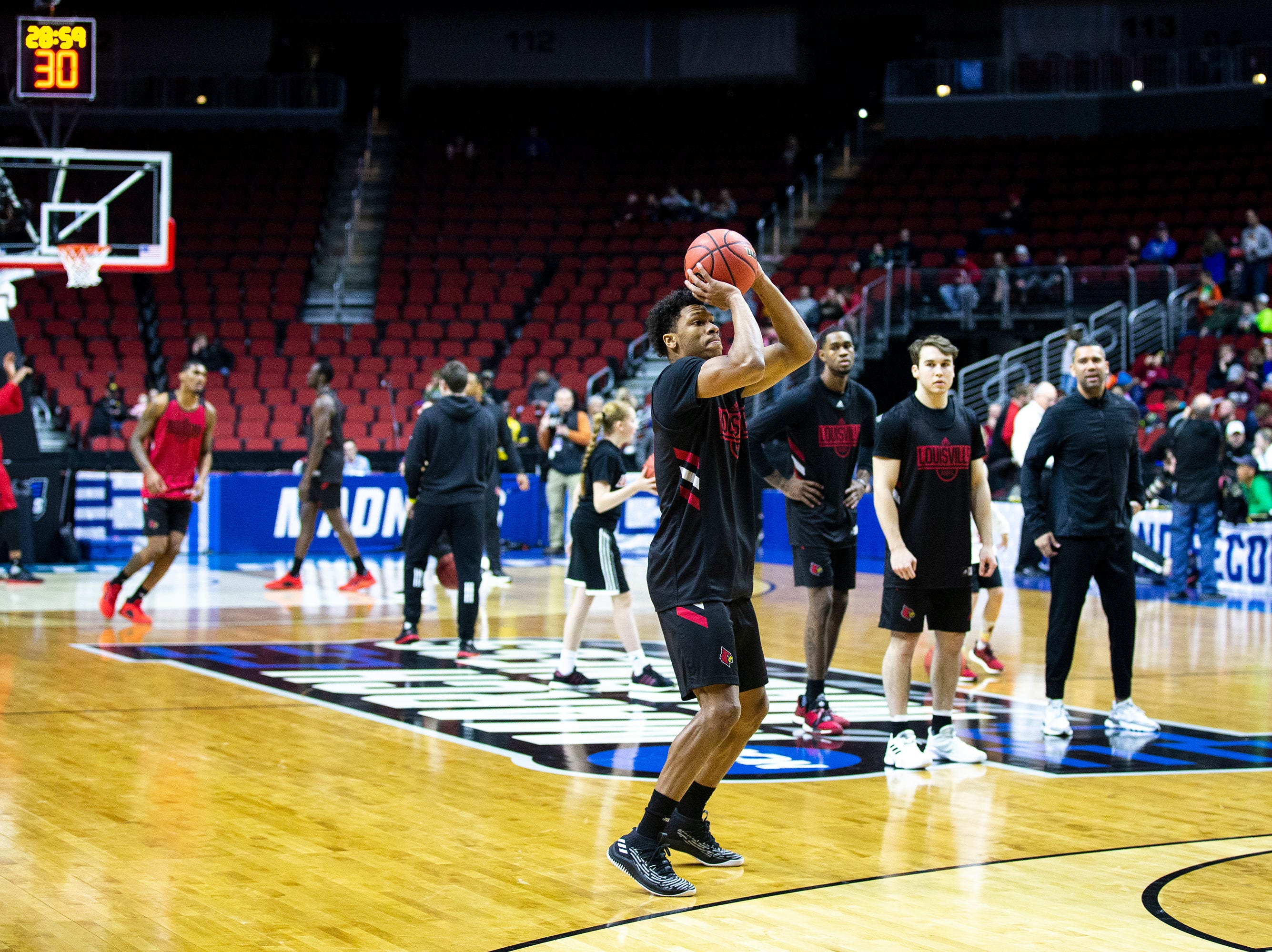 Louisville's Dwayne Sutton shoots from the three-point line during Louisville's open practice before the first round of the NCAA Men's Basketball Tournament on Wednesday, March 20, 2019, at Wells Fargo Arena in Des Moines, Iowa.