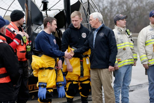 Vice President Mike Pence meets volunteers and first responders who had helped victims of the recent flooding, in Omaha, Neb., Tuesday, March 19, 2019. (AP Photo/Nati Harnik)